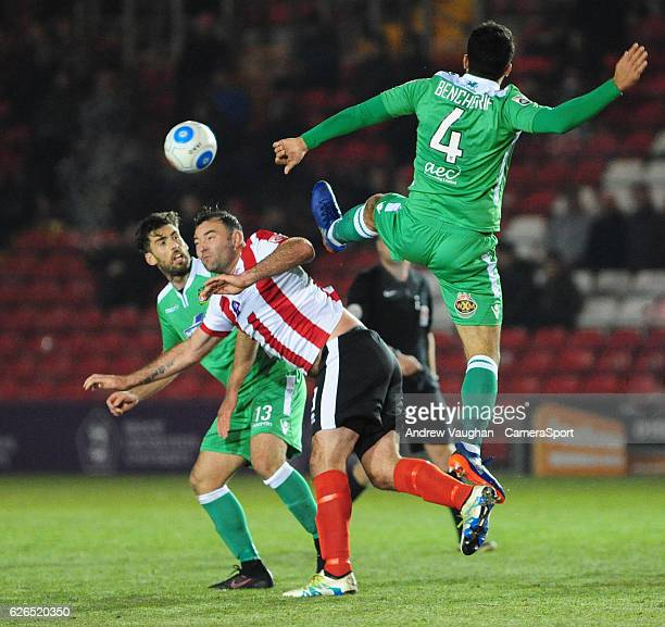 Lincoln City's Matt Rhead is fouled by Wrexham's Hamza Bencherif during the Vanarama National League match between Lincoln City and Wrexham at Sincil...