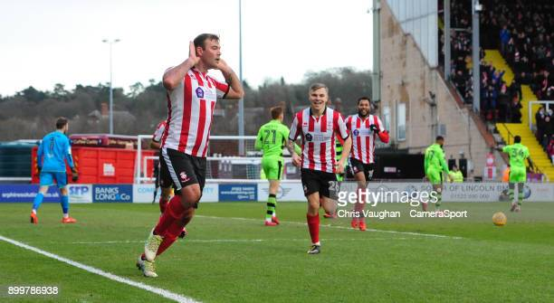 Lincoln City's Matt Rhead left celebrates scoring the opening goal during the Sky Bet League Two match between Lincoln City and Forest Green Rovers...