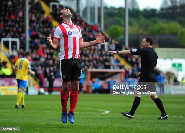 Lincoln City's Matt Rhead reacts after missing a chance during the Vanarama National League match between Lincoln City and Torquay United at Sincil...