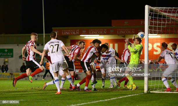 Lincoln City's Matt Rhead scores his sides second goal during the Vanarama National League match between Lincoln City and Dagenham and Redbridge at...