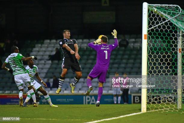 Lincoln City's Matt Rhead scores his sides second goal heading the ball past Yeovil Town's Artur Krysiak during the Sky Bet League Two match between...