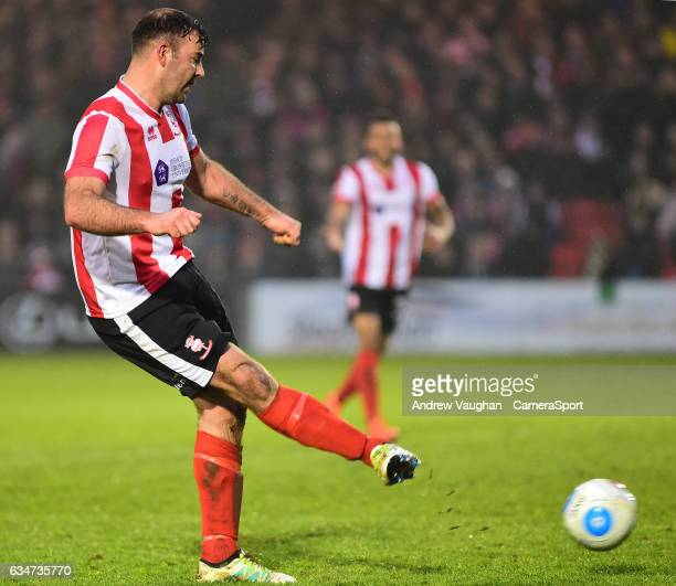 Lincoln City's Matt Rhead scores his sides third goal during the Vanarama National League match between Lincoln City and Woking at Sincil Bank...