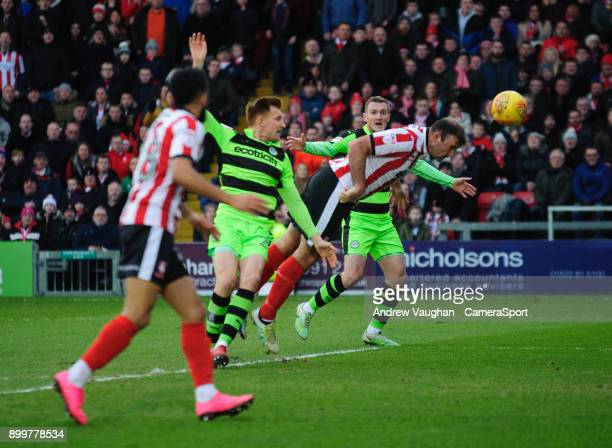 Lincoln City's Matt Rhead scores the opening goal during the Sky Bet League Two match between Lincoln City and Forest Green Rovers at Sincil Bank...