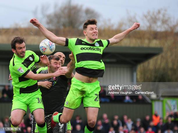 Lincoln City's Matt Rhead under pressure from Forest Green Rovers' Gavin Gunning left and Paul Digby during the Sky Bet League Two match between...