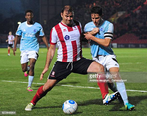 Lincoln City's Matt Rhead vies for possession with Aldershot Town's Callum Reynolds during the Vanarama National League match between Lincoln City...