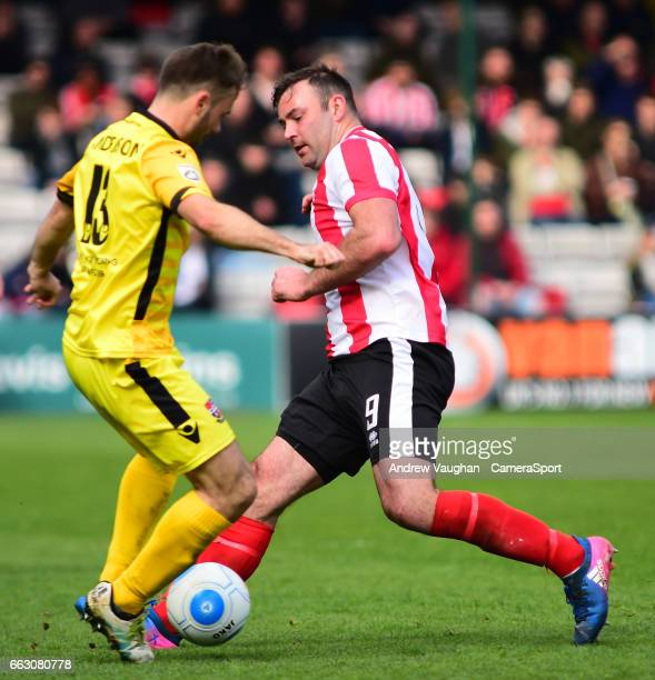 Lincoln City's Matt Rhead vies for possession with Bromley's Joe Anderson during the Vanarama National League match between Lincoln City and Bromley...