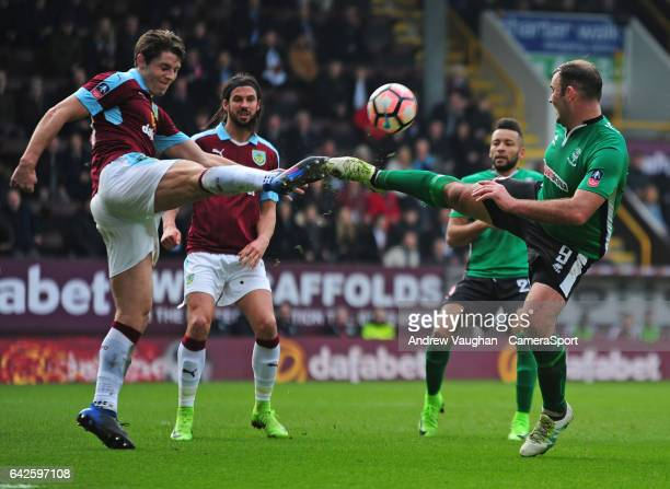 Lincoln City's Matt Rhead vies for possession with Burnley's James Tarkowski during The Emirates FA Cup Fifth Round match between Burnley and Lincoln...