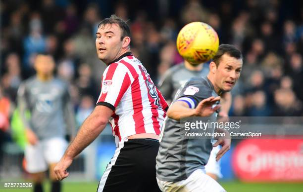 Lincoln City's Matt Rhead vies for possession with Coventry City's Michael Doyle during the Sky Bet League Two match between Lincoln City and...