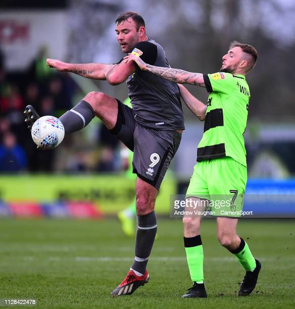 Lincoln City's Matt Rhead vies for possession with Forest Green Rovers' Carl Winchester during the Sky Bet League Two match between Forest Green...