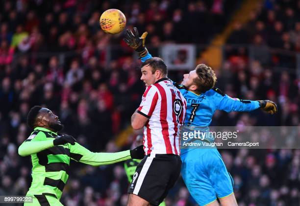 Lincoln City's Matt Rhead vies for possession with Forest Green Rovers' Bradley Collins during the Sky Bet League Two match between Lincoln City and...