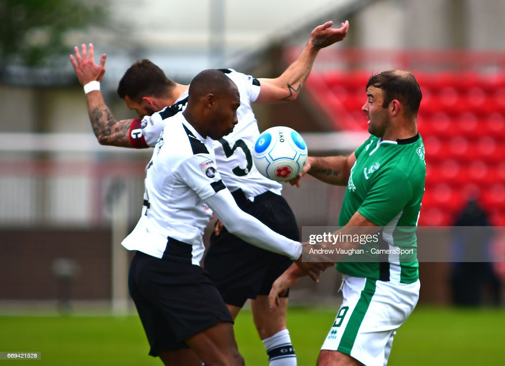 Lincoln City's Matt Rhead vies for possession with Gateshead's Liam Hogan and Emanuel Smith during the Vanarama National League match between Gateshead and Lincoln City at on April 17, 2017 in Gateshead, England.