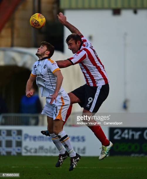 Lincoln City's Matt Rhead vies for possession with Port Vale's James Gibbons during the Sky Bet League Two match between during the Sky Bet League...