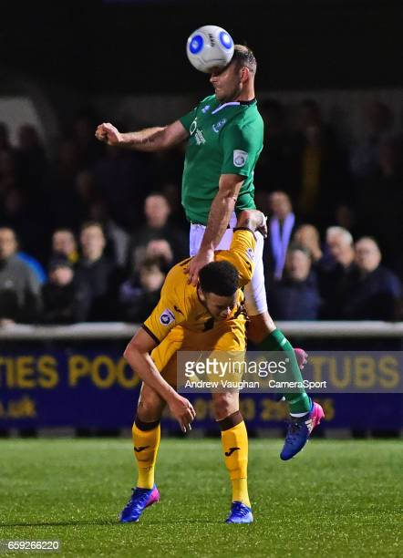 Lincoln City's Matt Rhead vies for possession with Sutton United's Louis John during the Vanarama National League match between Sutton United and...