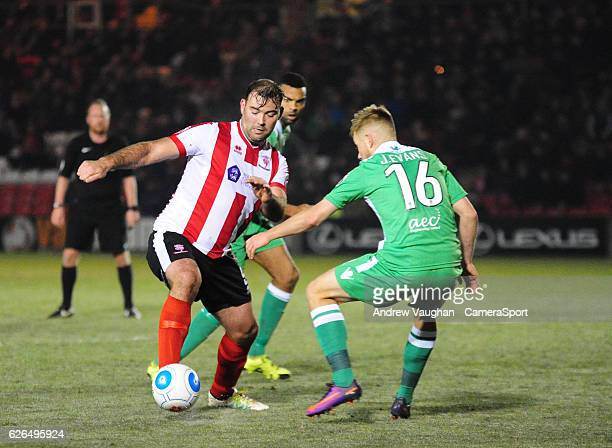 Lincoln City's Matt Rhead vies for possession with Wrexham's Jordan Evans during the Vanarama National League match between Lincoln City and Wrexham...