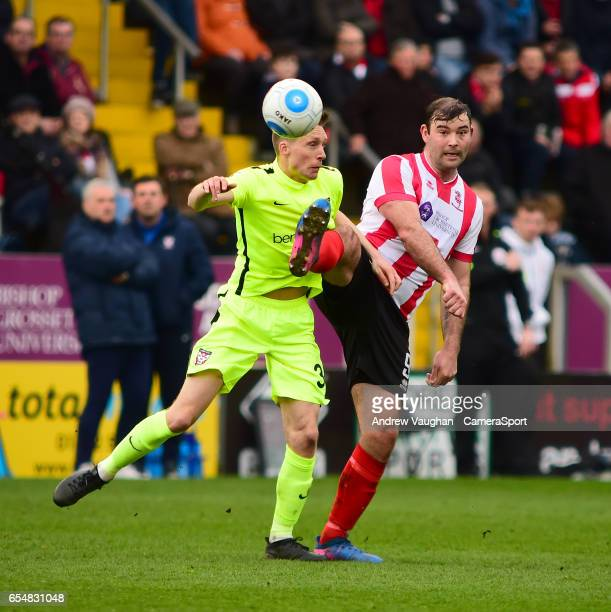 Lincoln City's Matt Rhead vies for possession with York City's Daniel Parslow during the Buildbase FA Trophy Semi Final Second Leg match between...