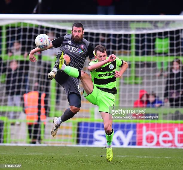 Lincoln City's Michael Bostwick battles with Forest Green Rovers' Christian Doidge during the Sky Bet League Two match between Forest Green Rovers...