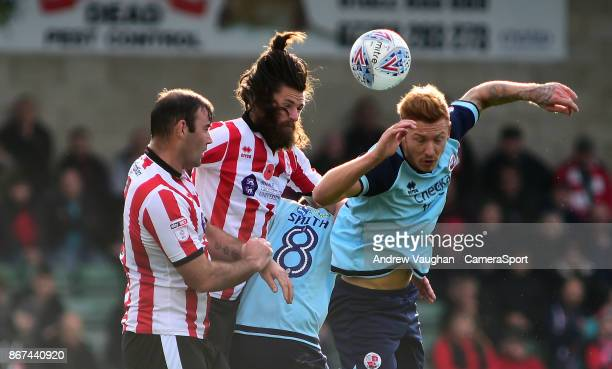 Lincoln City's Michael Bostwick vies for possession with Crawley Town's Josh Yorwerth during the Sky Bet League Two match between Lincoln City and...