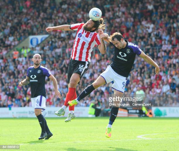 Lincoln City's Michael Bostwick vies for possession with Luton Town's Danny Hylton during the Sky Bet League Two match between Lincoln City and Luton...