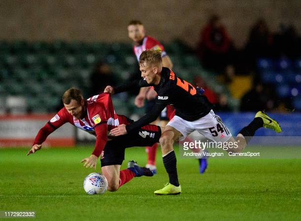 Lincoln City's Michael O'Connor battles with Manchester United U21's Ethan Galbraith during the EFL Leasingcom Trophy Northern Section Group H match...