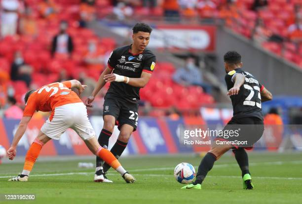 Lincoln City's Morgan Rogers and Blackpool's Elliot Embleton during the Sky Bet League One Play-off Final match between Blackpool and Lincoln City at...