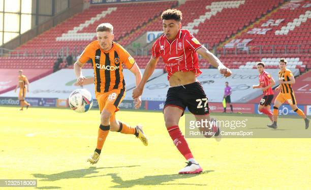 Lincoln City's Morgan Rogers vies for possession with Hull City's Regan Slater during the Sky Bet League One match between Lincoln City and Hull City...