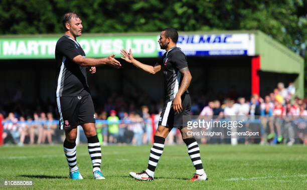 Lincoln City's Nathan Arnold right celebrates scoring his sides fourth goal with teammate Matt Rhead during the preseason friendly match between...
