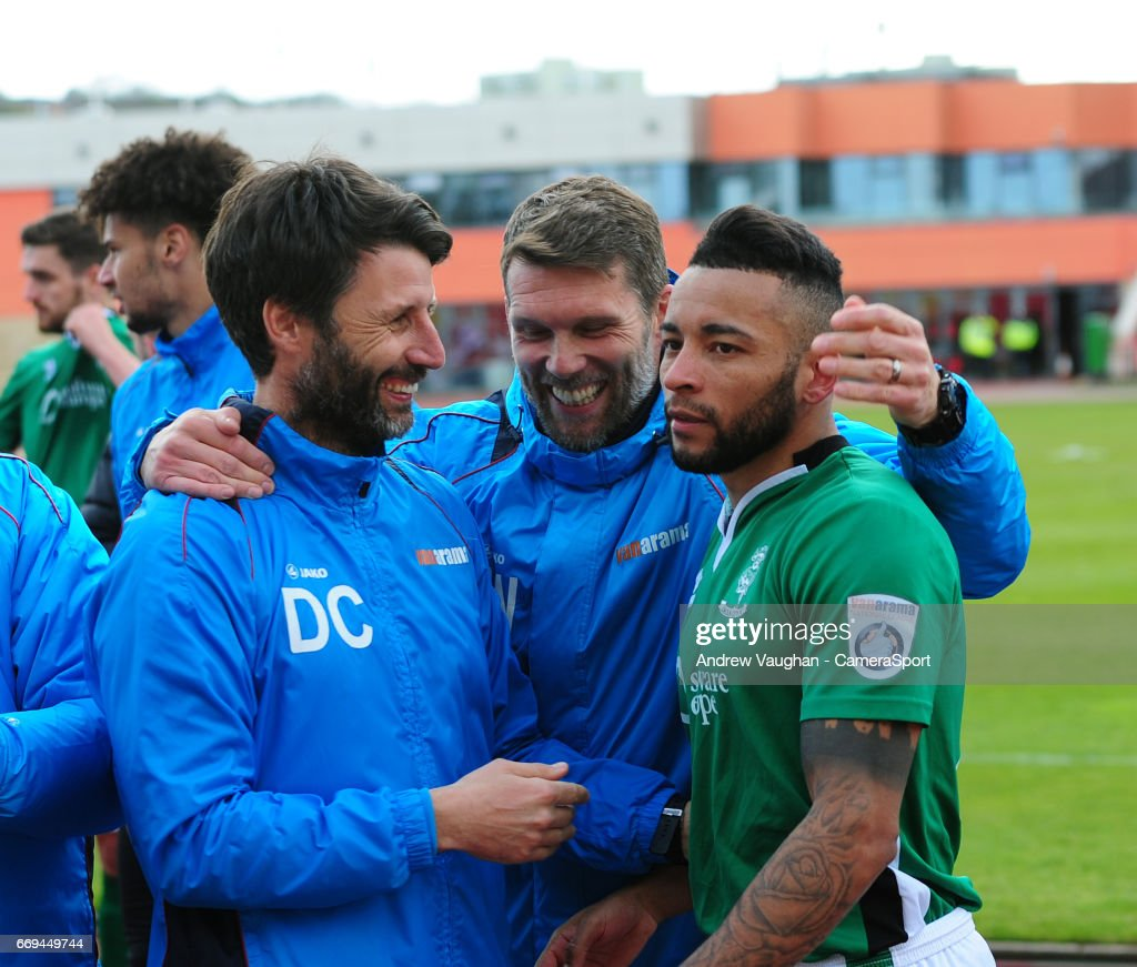 Lincoln City's Nathan Arnold, right, celebrates the win with Lincoln City manager Danny Cowley, left, and Jimmy Walker following the Vanarama National League match between Gateshead and Lincoln City at on April 17, 2017 in Gateshead, England.