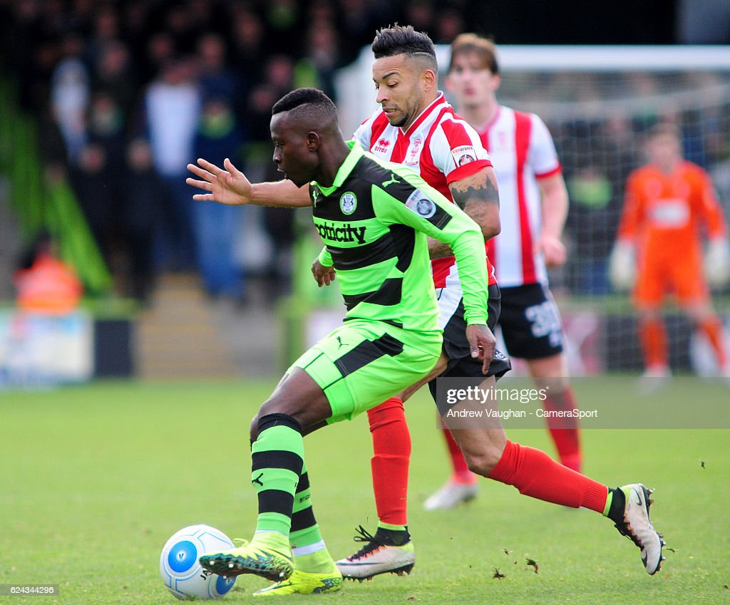 Lincoln City's Nathan Arnold vies for possession with Forest Green Rovers' Drissa Traore during the Vanarama National League match between Forest Green Rovers and Lincoln City at on November 19, 2016 in Nailsworth, England.