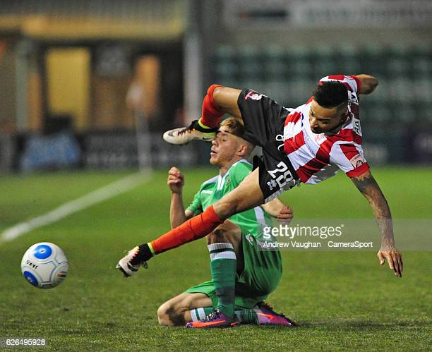 Lincoln City's Nathan Arnold vies for possession with Wrexham's Jordan Evans during the Vanarama National League match between Lincoln City and...
