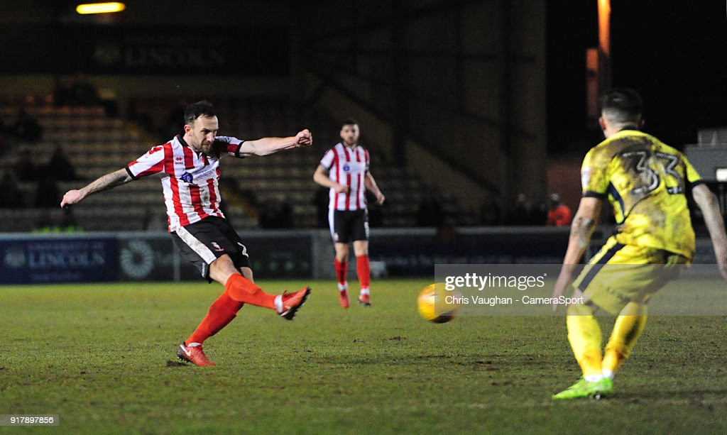 Lincoln City's Neal Eardley scores the opening goal during the Sky Bet League Two match between Lincoln City and Cheltenham Town at Sincil Bank Stadium on February 13, 2018 in Lincoln, England.