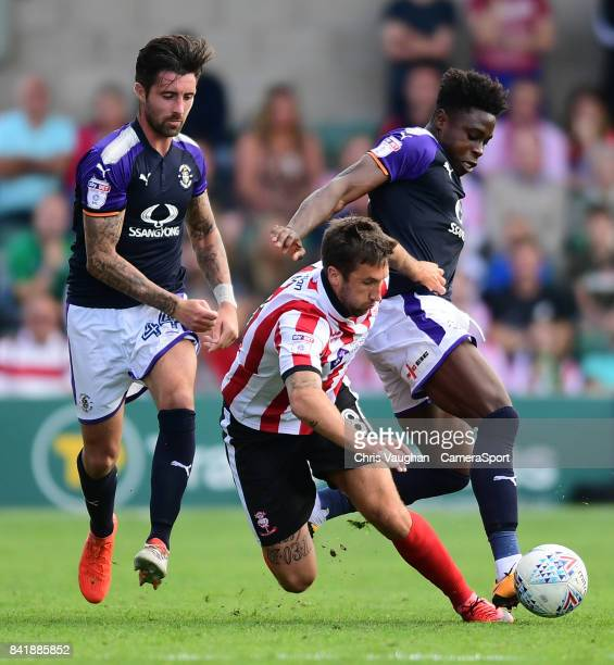 Lincoln City's Ollie Palmer vies for possession with Luton Town's Alan Sheehan left and Luton Town's Pelly Ruddock during the Sky Bet League Two...