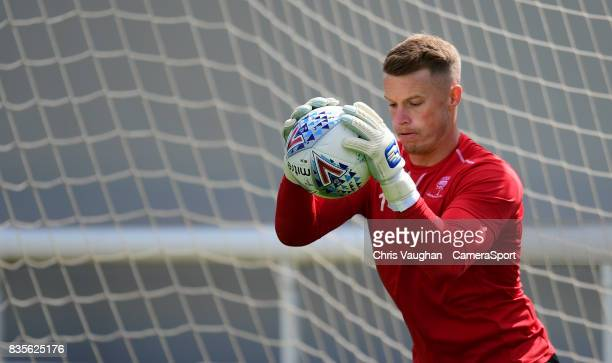 Lincoln City's Paul Farman during the prematch warmup prior to the Sky Bet League Two match between Exeter City and Lincoln City at St James Park on...