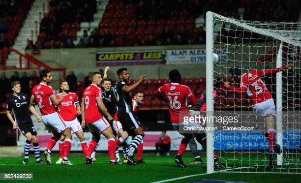Lincoln City's Rob Dickie centre has a header cleared off the line by Swindon Town's Matthew Taylor during the Sky Bet League Two match between...