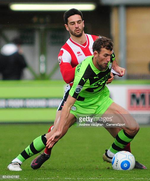Lincoln City's Sam Habergham vies for possession with Forest Green Rovers' Christian Doidge during the Vanarama National League match between Forest...