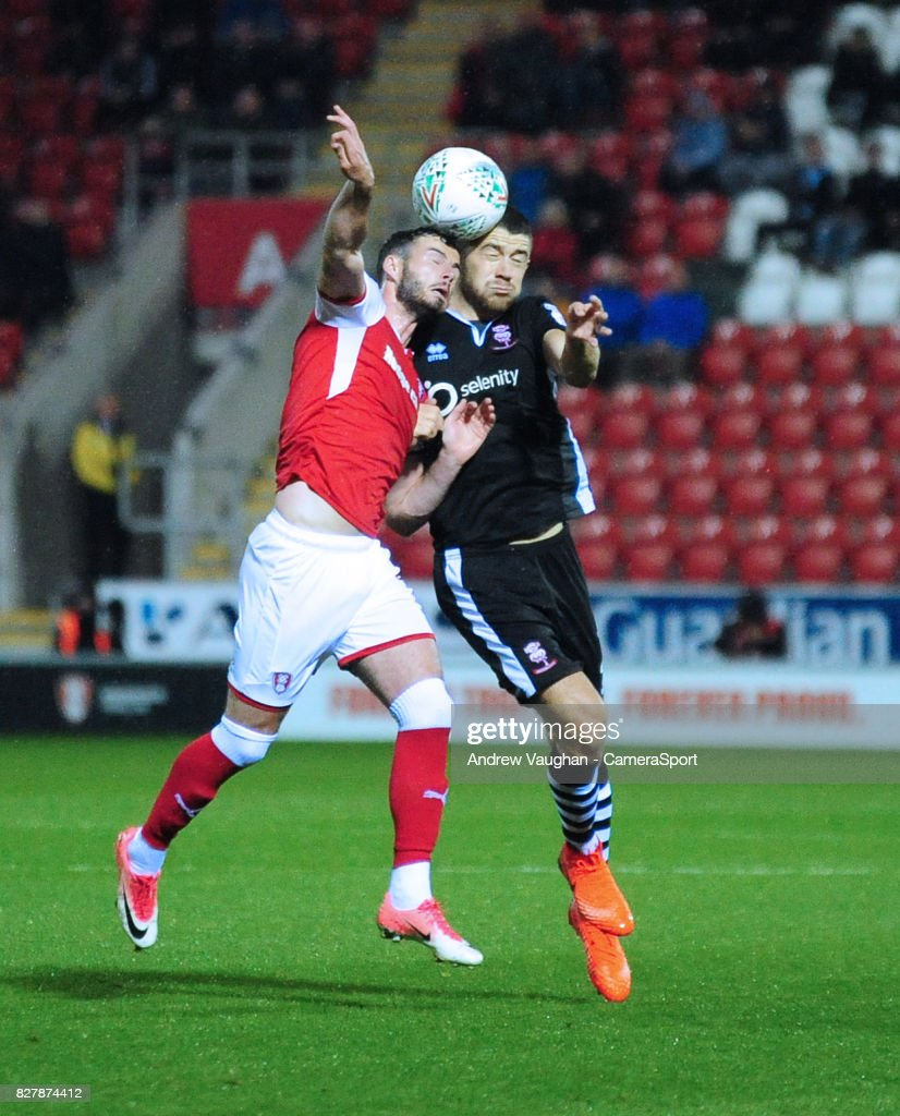 Lincoln City's Sean Long vies for possession with Rotherham United's Anthony Forde during the Carabao Cup First Round match between Rotherham United and Lincoln City at Millmoor Ground on August 8, 2017 in Rotherham, England.
