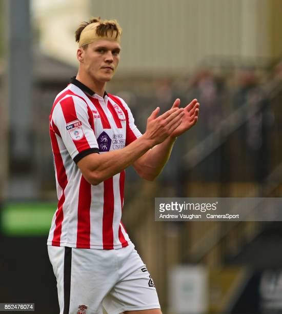 Lincoln City's Sean Raggett applauds the fans at the final whistle following the Sky Bet League Two match between Notts County and Lincoln City at...
