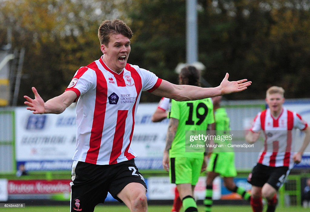 Lincoln City's Sean Raggett celebrates scoring his sides third goal during the Vanarama National League match between Forest Green Rovers and Lincoln City at on November 19, 2016 in Nailsworth, England.