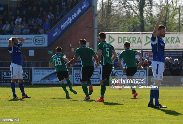 Lincoln City's Sean Raggett, right turns away to celebrate his goal during the Vanarama National League match between Eastleigh and Lincoln City at...
