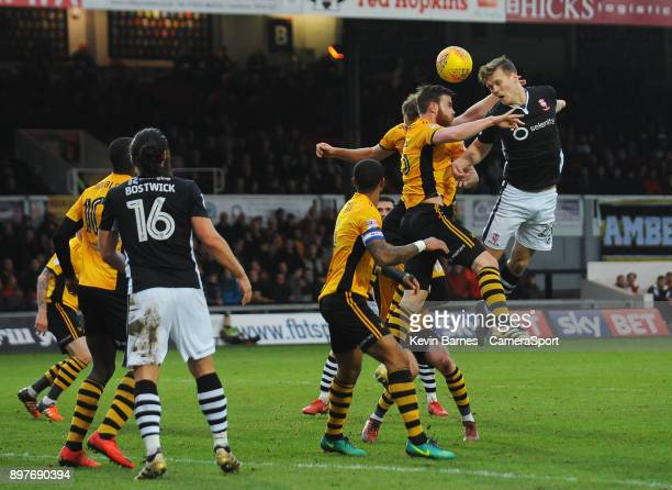 Lincoln City's Sean Raggett vies for possession with Newport County's Mark O'Brien during the Sky Bet League Two match between Newport County and...