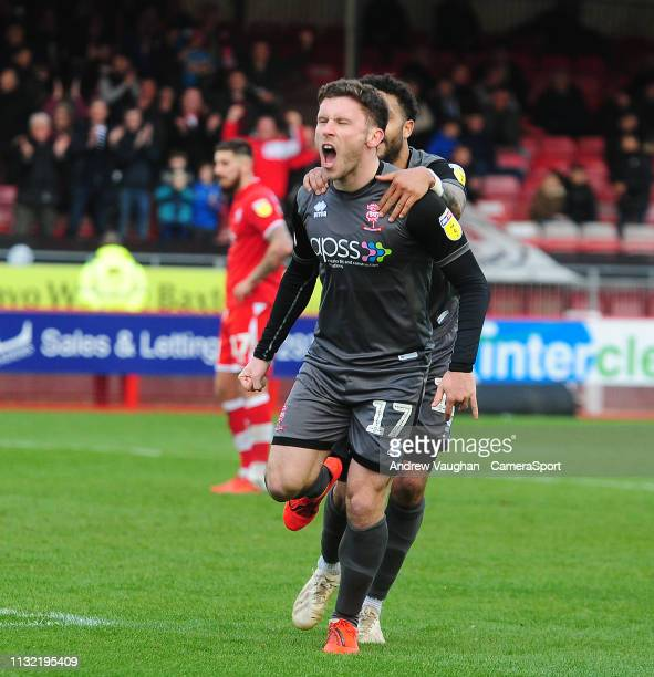 Lincoln City's Shay McCartan celebrates scoring his side's second goal with teammate Bruno Andrade during the Sky Bet League Two match between...