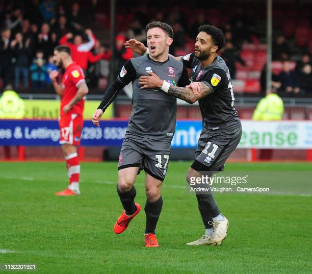 Lincoln City's Shay McCartan left celebrates scoring his side's second goal with teammate Bruno Andrade during the Sky Bet League Two match between...