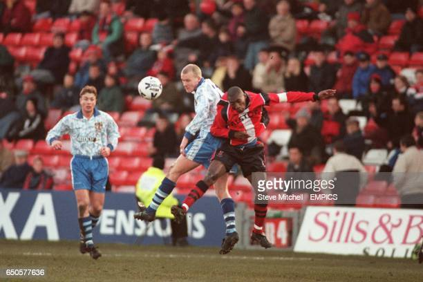 Lincoln City's Terry Fleming and Stevenage Borough's Robbie Reinelt battle in the air.