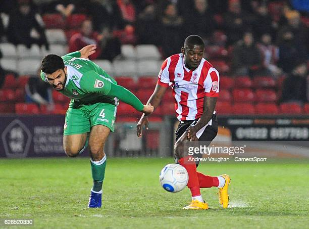 Lincoln Citys Theo Robinson vies for possession with Wrexham's Hamza Bencherif during the Vanarama National League match between Lincoln City and...