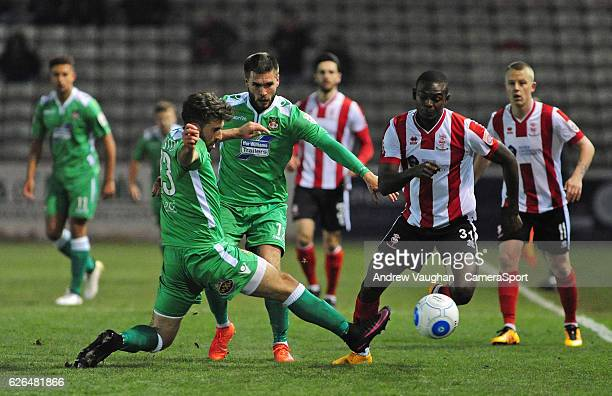 Lincoln Citys Theo Robinson vies for possession with Wrexham's Mark Carrington during the Vanarama National League match between Lincoln City and...