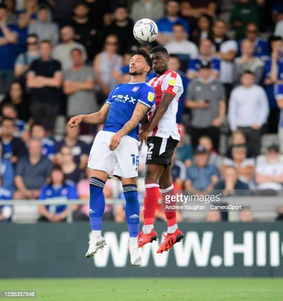 Lincoln City's TJ Eyoma vies for possession with Ipswich Town's Macauley Bonne during the Sky Bet League One match between Lincoln City and Ipswich...
