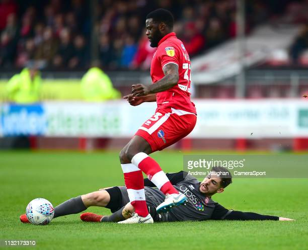 Lincoln City's Tom Pett battles with Crawley Town's Bondz Ngala during the Sky Bet League Two match between Crawley Town and Lincoln City at...