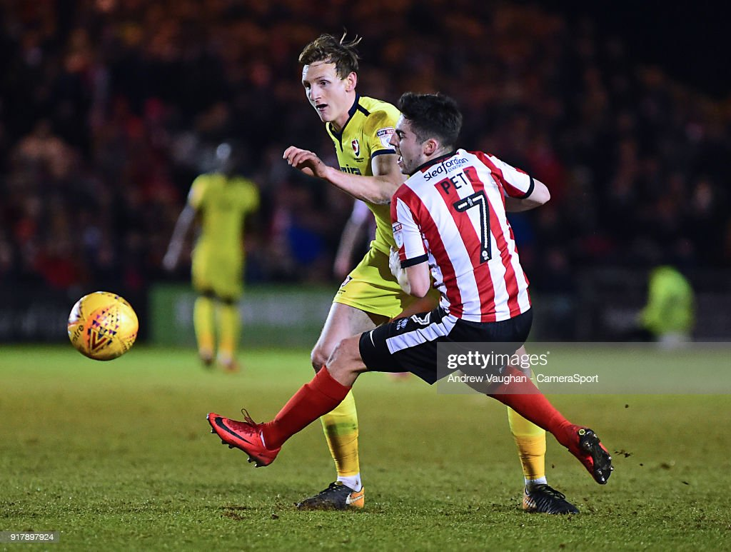 Lincoln City's Tom Pett is fouled by Cheltenham Town's William Boyle during the Sky Bet League Two match between Lincoln City and Cheltenham Town at Sincil Bank Stadium on February 13, 2018 in Lincoln, England.