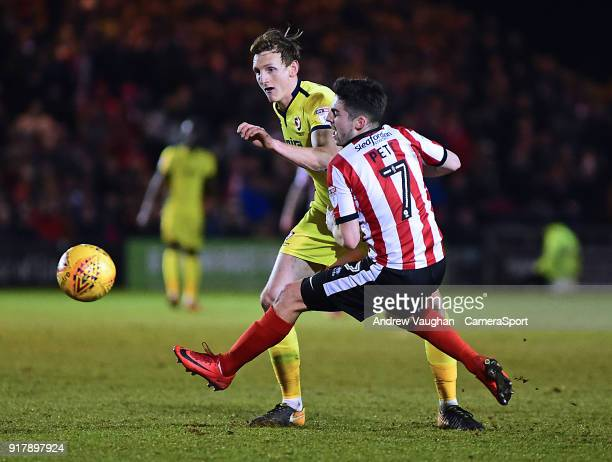 Lincoln City's Tom Pett is fouled by Cheltenham Town's William Boyle during the Sky Bet League Two match between Lincoln City and Cheltenham Town at...