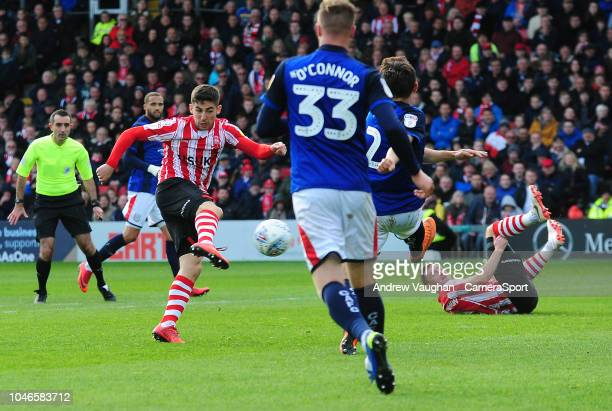 Lincoln City's Tom Pett scores the opening goal during the Sky Bet League Two match between Lincoln City and Crewe Alexandra at Sincil Bank Stadium...