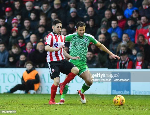Lincoln City's Tom Pett vies for possession with Swindon Town's Ben Purkiss during the Sky Bet League Two match between Lincoln City and Swindon Town...